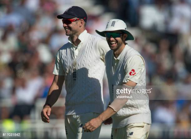 Jimmyu Anderson and Mark Wood of England share a joke during the third day of the second test between England and South Africa at Trent Bridge on...