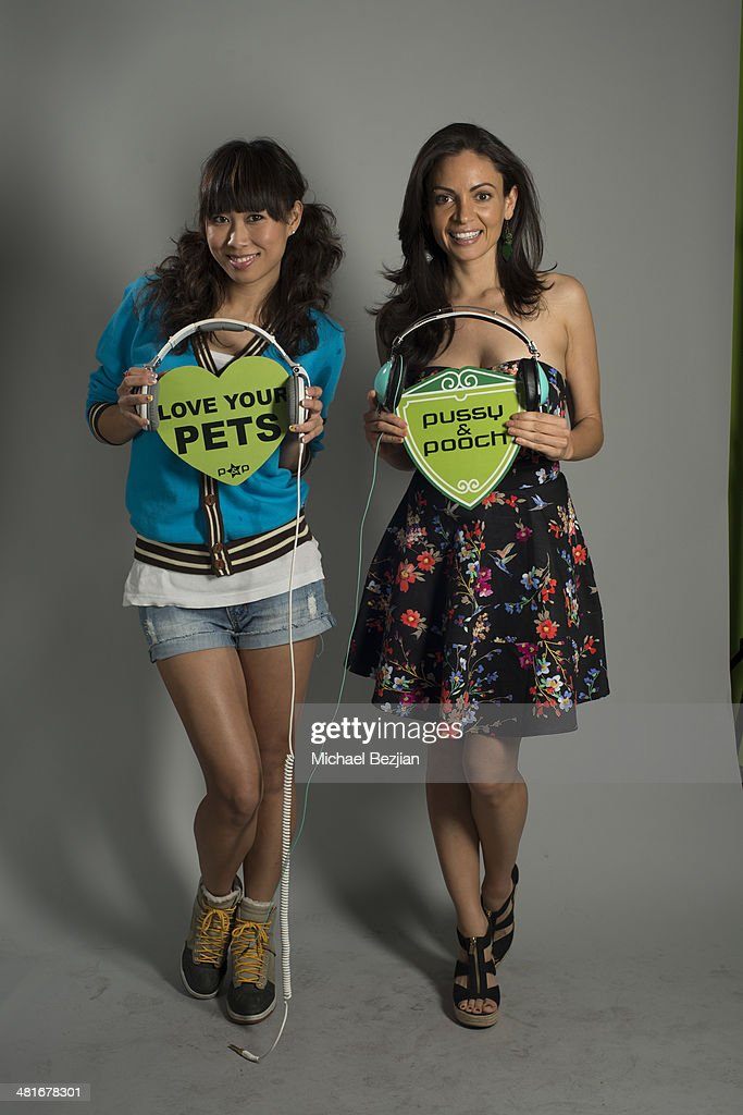 DJ Jin Baik aka DJ Shy and Sandra Luesse pose for Portraits For Pooches on March 30, 2014 in Beverly Hills, California.