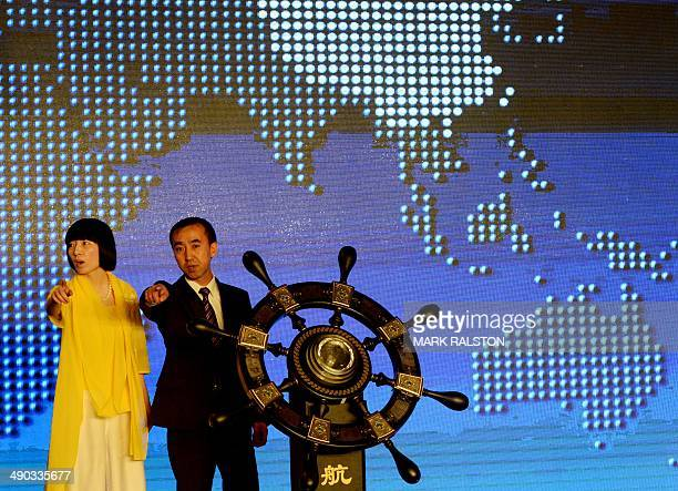 Jin Chenglong who is the chairman of the new Elephant Alliance Global Economy and Trade Platform gestures at the launch ceremony in Beijing on May 14...