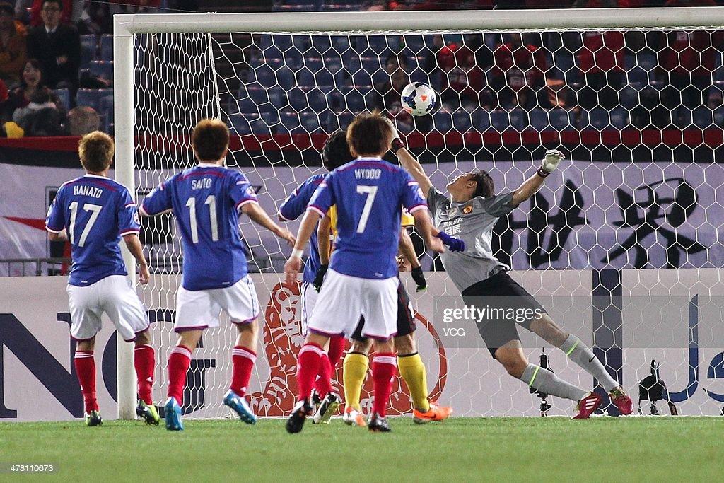 Jin Hanato #17 of Yokohama F. Marinos scores his team's first goal during the AFC Asian Champions League match between Yokohama F. Marinos and Guangzhou Evergrande at the Nissan Stadium on March 12, 2014 in Yokohama, Japan.