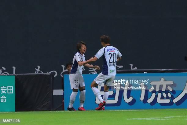 Jin Izumisawa of Gamba Osaka celebrates scoring his side's second goal with his team mate Shun Nagasawa during the JLeague J1 match between Consadole...