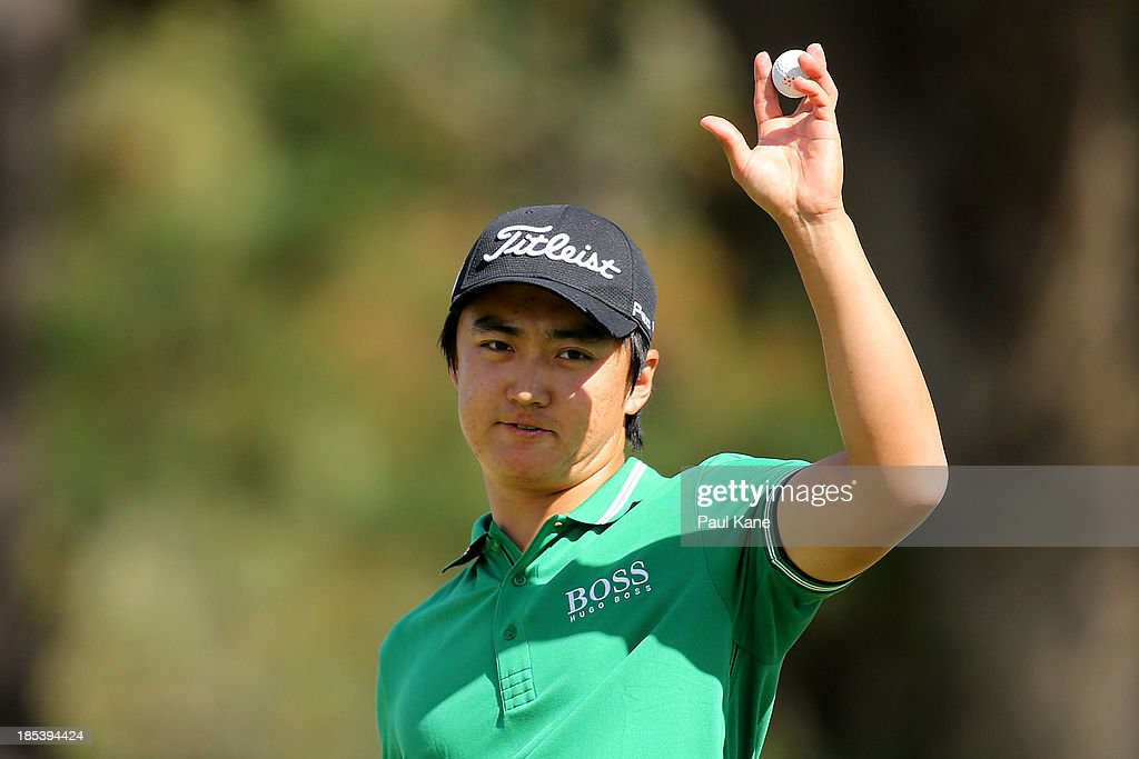 Jin Jeong of Korea acknowledges the gallery on the 18th green after completing his round to force a play off with Ross Fisher of England on day four of the Perth International at Lake Karrinyup Country Club on October 20, 2013 in Perth, Australia.