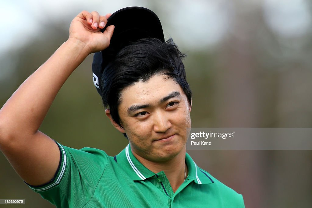 Jin Jeong of Korea celebrates on the 18th hole after winning a play-off hole against Ross Fisher of England to win the Perth International at Lake Karrinyup Country Club on October 20, 2013 in Perth, Australia.
