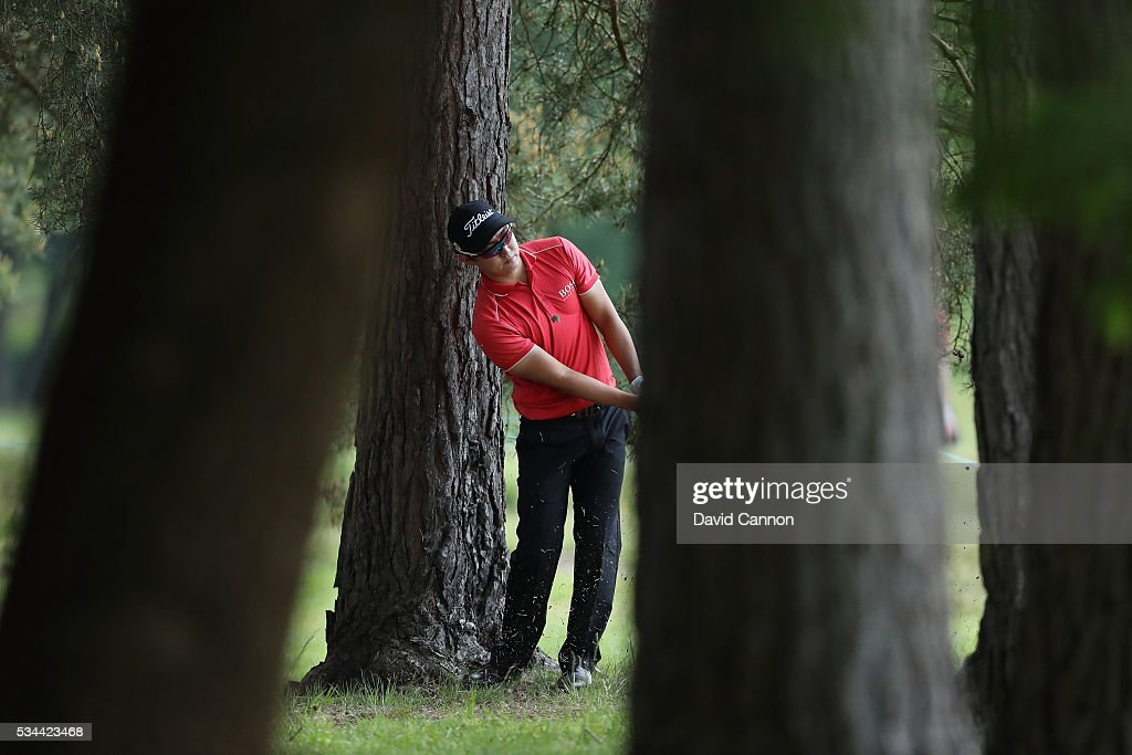 Jin Jeong of Korea hits his 2nd shot on the 9th hole during day one of the BMW PGA Championship at Wentworth on May 26, 2016 in Virginia Water, England.