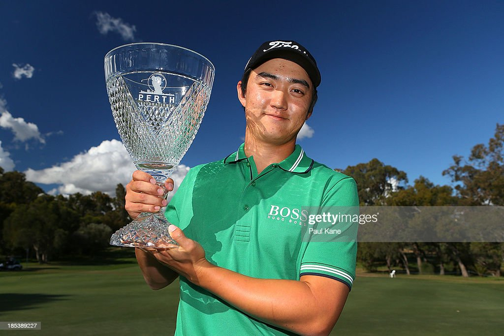 Jin Jeong of Korea holds aloft the winners trophy after winning a play-off hole against Ross Fisher of England on at the 3rd green during day four of the Perth International at Lake Karrinyup Country Club on October 20, 2013 in Perth, Australia.