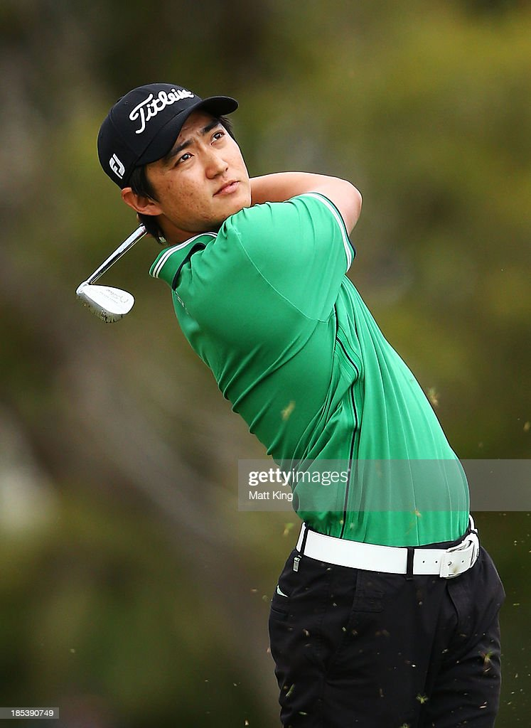 Jin Jeong of Korea plays his approach shot on the 14th hole during day four of the Perth International at on October 20, 2013 in Perth, Australia.