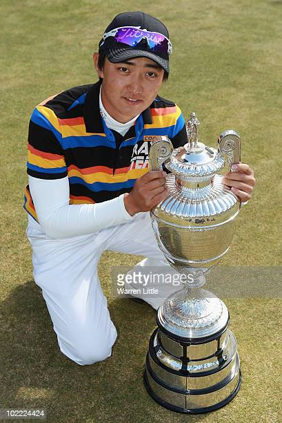 Jin Jeong of South Korea poses with the trophy after beating James Byrne of Scotland 54 to win The Amateur Championship at Muirfield Golf Club on...