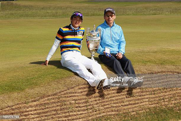 Jin Jeong of South Korea poses with the trophy with father and caddie Mok Hwa Jeong after beating James Byrne of Scotland 54 to win The Amateur...