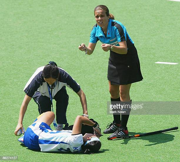 Jin Kyoung Kim of South Korea lies injured during the Women's Hockey Champions Trophy first round match between South Korea and China at the Canberra...