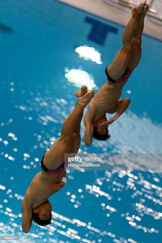 Jin Lin and Su Zewan of China perform in the men's synchronised 3m springboard diving comptition at the 9th Asian Swimming Championships in Dubai, on November 22, 2012. China won the gold medal in the event.