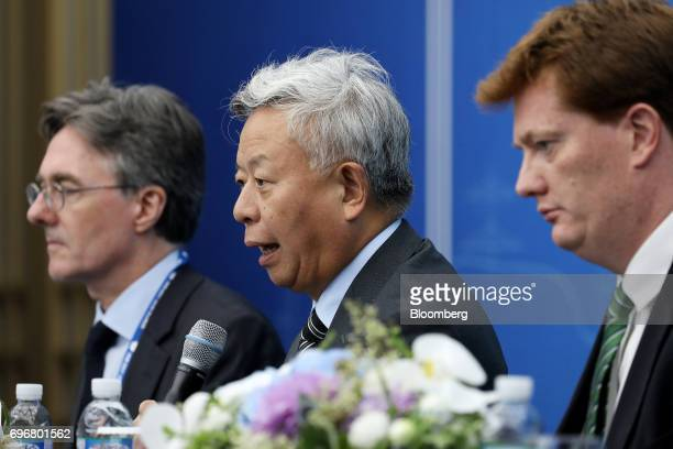 Jin Liqun president of the Asian Infrastructure Investment Bank center speaks during a news conference conference at the AIIB annual meeting in Jeju...