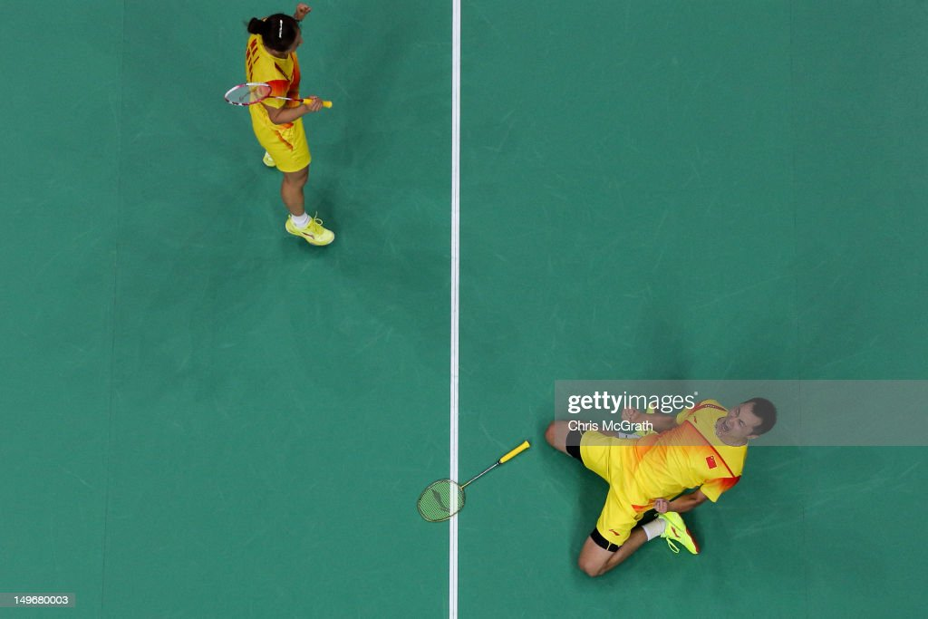 Jin Ma (L) and Chen Xu (R) of China celebrate victory over Tontowi Ahmad and Lilyana Natsir of of Indonesia in their Mixed Doubles Badminton semi final on day 6 of the London 2012 Olympic Games at Wembley Arena on August 2, 2012 in London, England.