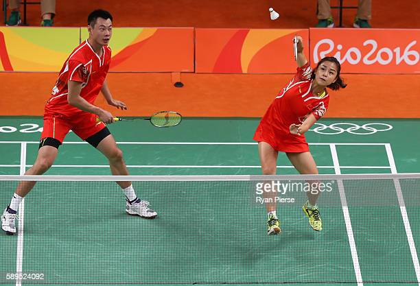 Jin Ma and Chen Xu of China play a shot during their Mixed Doubles Quarter Final match against Korea during on Day 9 of the Rio 2016 Olympic Games at...