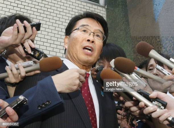 Jin Matsubara a veteran member of the main opposition Democratic Party and former head of the National Public Safety Commission speaks to reporters...