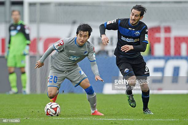 Jin Su Kim of Hoffenheim and Mario Vrancic of Paderborn fight for the ball during the Bundesliga match between SC Paderborn and TSG Hoffenheim at...