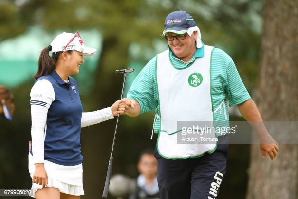 Jin Young Ko of South Korea celebrates after making her birdie putt on the 7th hole during the final round of the World Ladies Championship Salonpas...