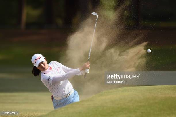 Jin Young Ko of South Korea hits out of the 13th green bunker during the third round of the World Ladies Championship Salonpas Cup at the Ibaraki...