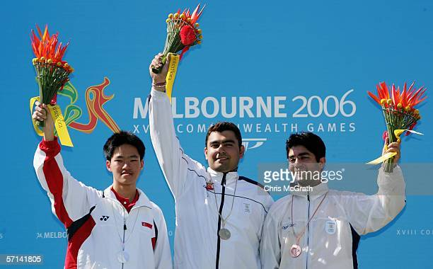 Jin Zhang of Singapore Gagan Narang of India and Abhinav Bindra of India pose with their medals after the Men's 10m Air Rifle Final at the Melbourne...