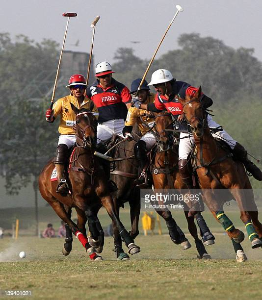 JindalElevation and Trident players vying for the ball during the final of the Maharaja Jiwaji Rao Scindia Gold Cup between JindalElevation and...