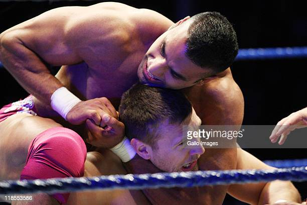 Jinder Mahal puts a headlock on Daniel Bryan during the WWE Smackdown Live Tour at Westridge Park Tennis Stadium on July 08 2011 in Durban South...