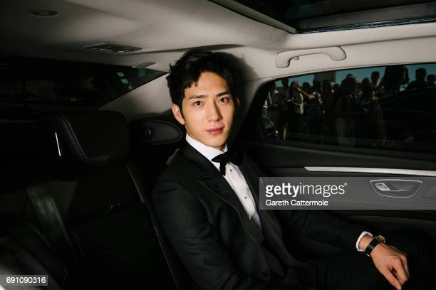 Jing Boran departs the Martinez Hotel during the 70th annual Cannes Film Festival on May 20 2017 in Cannes France