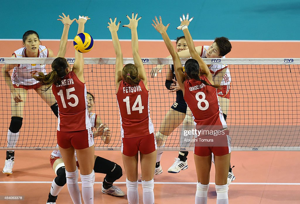 Jing Li of China spikes the ball during the FIVB World Grand Prix Final group one match between Russia and China on August 24, 2014 in Tokyo, Japan.