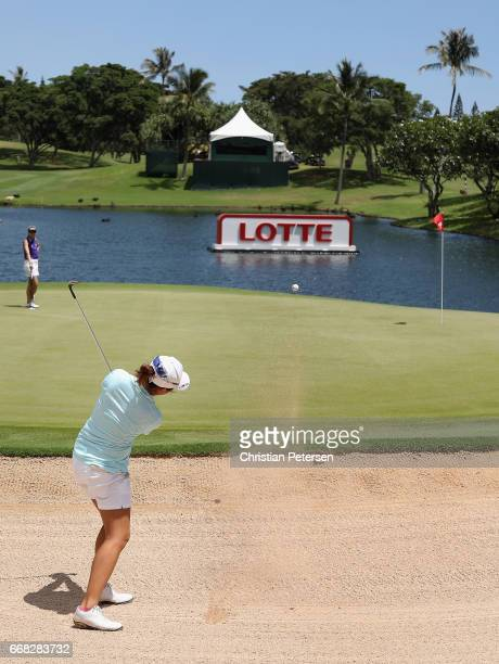 Jing Yan of China chips from the bunker onto the 18th green during the second round of the LPGA LOTTE Championship Presented By Hershey at Ko Olina...