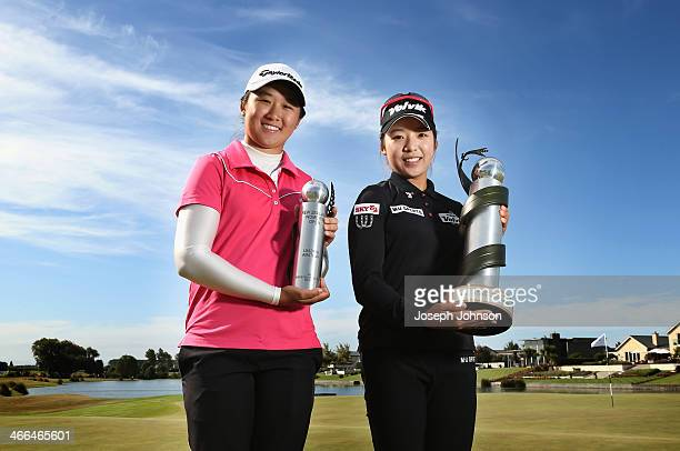 Jing Yan of China with the leading amateur trophy Mi Hyang Lee of Korea with the NZ Women's Open trophy after her win following the final round...