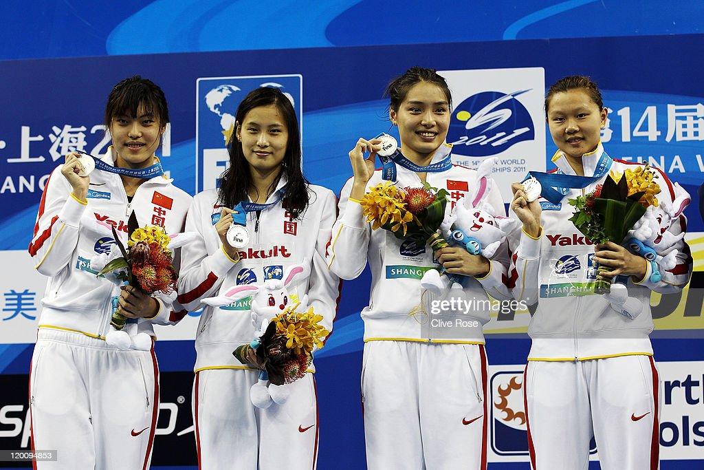 Jing Zhao, Liping Ji, Ying Lu and Yi Tang of China pose with their silver medals after the Women's 4x100m Medley Relay during Day Fifteen of the 14th FINA World Championships at the Oriental Sports Center on July 30, 2011 in Shanghai, China.