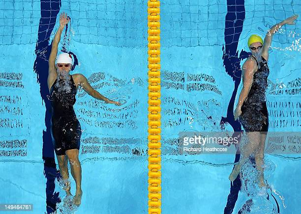 Jing Zhao of China and Emily Seebohm of Australia compete in the Women's 100m Backstroke heat 4 on Day 2 of the London 2012 Olympic Games at the...