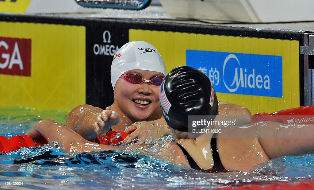 Jing Zhao of China (L) celebrates after winning gold in the women's 50m backstroke final during the Short Course Swimming World Championships in Istanbul on December 16, 2012.