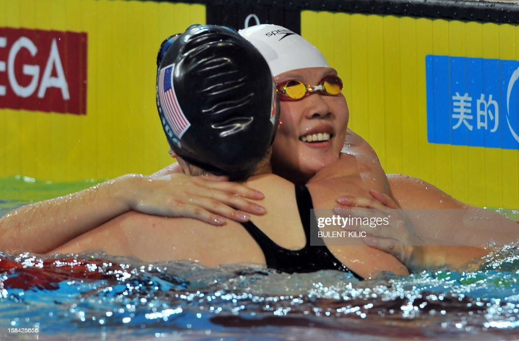 Jing Zhao of China celebrates after winning gold in the women's 50m backstroke final during the Short Course Swimming World Championships in Istanbul on December 16, 2012.