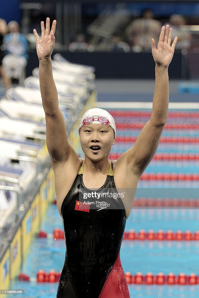 Jing Zhao of China celebrates winning the gold medal in the Women's 100m Backstroke Final during Day Eleven of the 14th FINA World Championships at the Oriental Sports Center on July 26, 2011 in Shanghai, China.