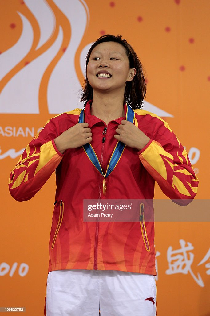 Jing Zhao of China poses with the gold medal won in the Women's 200m Backstroke final at the Aoti Aquatics Centre during day two of the 16th Asian Games Guangzhou 2010 on November 14, 2010 in Guangzhou, China.