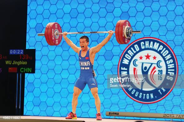 Jingbiao Wu of China breaks the world record with a snatch of 139kg in the men's 56kg weight class during the 2015 International Weightlifting...