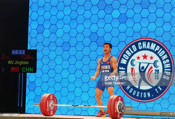 Jingbiao Wu of China celebrates after breaking the world record with a snatch of 139kg in the men's 56kg weight class during the 2015 International...
