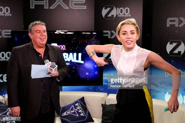 Jingle Ball host Elvis Duran and Miley Cyrus backstage at Z100's Jingle Ball 2013 presented by Aeropostale at Madison Square Garden on December 13...