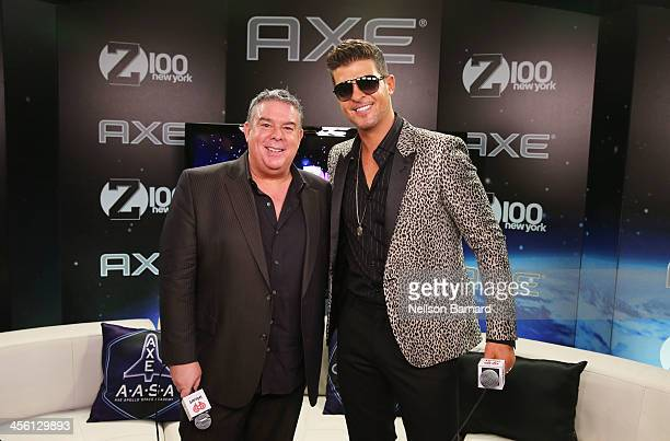 Jingle Ball host Elvis Duran and Robin Thicke pose backstage at Z100's Jingle Ball 2013 presented by Aeropostale at Madison Square Garden on December...