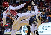 Jingyu Wu of China competes with MinAh Ha of Korea during the women's 49 kg final combat of WTF World Taekwondo Championships 2015 at the Traktor...