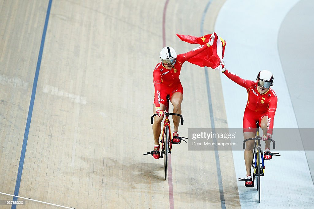 Jinjie Gong and Tianshi Zhong of China Cycling Team celebrate winning the gold medal in the Women's Team Sprint qualifying round as her coach yells during day 1 of the UCI Track Cycling World Championships held at National Velodrome on February 18, 2015 in Paris, France.
