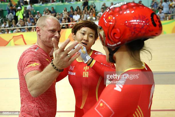 Jinjie Gong and Tianshi Zhong of Team China celebrates winning the gold medal with their coach after beating Team Russia in the Women's Team Sprint...