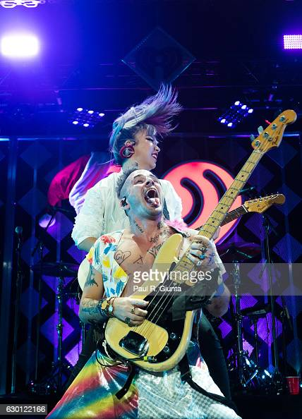 JinJoo Lee and Cole Whittle of DNCE perform on stage during Power 961's Jingle Ball 2016 at Phillips Arena on December 16 2016 in Atlanta Georgia