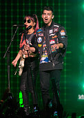 JinJoo Lee and Joe Jonas of DNCE perform during the Revival Tour at The Palace of Auburn Hills on June 25 2016 in Auburn Hills Michigan