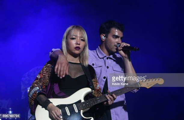 JinJoo Lee and Joe Jonas of DNCE perform on stage during the 2017 BLI Summer Jam at Nikon at Jones Beach Theater on June 16 2017 in Wantagh New York