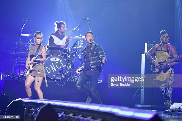 JinJoo Lee Jack Lawless Joe Jonas and Jack Lawless of DNCE performs onstage during TIDAL X 1015 on October 15 2016 in New York City
