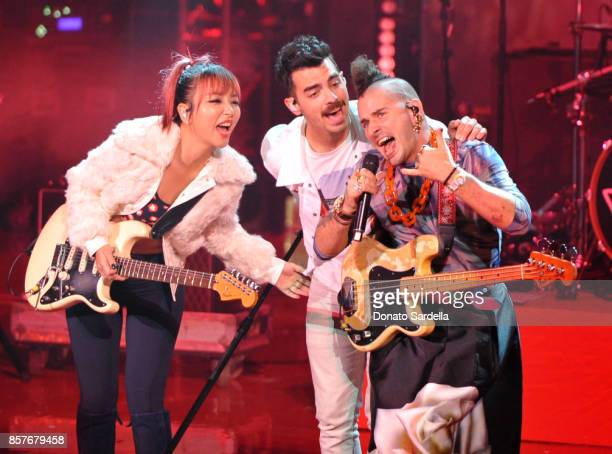 JinJoo Lee Joe Jonas and Cole Whittle of DNCE perform onstage at the Westfield Century City Reopening Celebration on October 3 2017 in Century City...