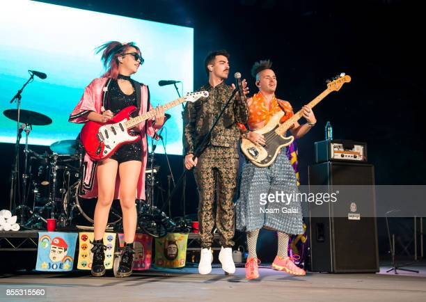 JinJoo Lee Joe Jonas and Cole Whittle of DNCE performs during Capital One Concert Takeover featuring DNCE BOB QuestLove and DJ Moma at Central Park...