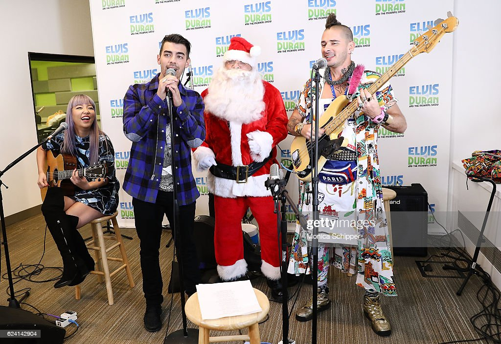 JinJoo Lee, Joe Jonas, Cole Whittle and Jack Lawless of band DNCE are joined by Greg T as Santa when DNCE visits 'The Elvis Duran Z100 Morning Show' at Z100 Studio on November 18, 2016 in New York City.