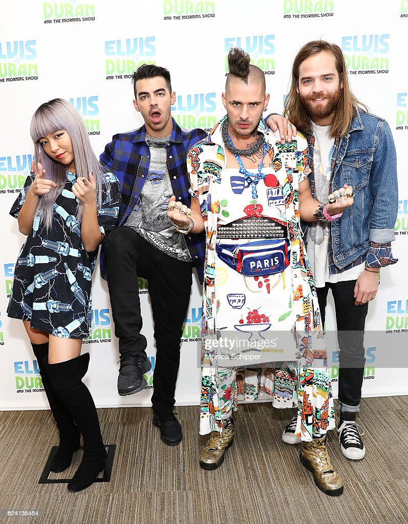 JinJoo Lee, Joe Jonas, Cole Whittle and Jack Lawless of band DNCE pose for a photo when DNCE visits 'The Elvis Duran Z100 Morning Show' at Z100 Studio on November 18, 2016 in New York City.