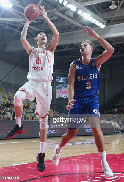 Jinqiu Hu and Mitch Young during the match between the Brisbane Bullets and China at the Gold Coast Sports Leisure Centre on July 18 2017 in Gold...
